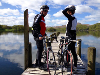 Cyclists on Coniston Jetty